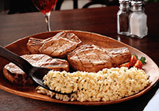 Savory Grilled Pork Chops and Parmesan Romano Rice)